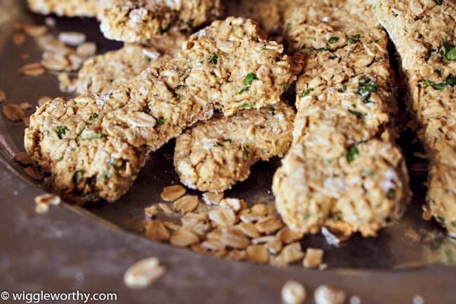 Oat, applesauce and chicken dog treats on metal plate