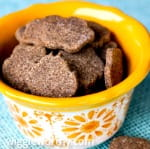 Peanut butter banana and coconut dog treats in yellow patterned bowl