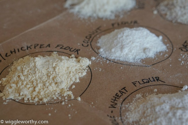 Chickpea flour, coconut flour, whole-wheat flour, labeled samples on brown paper