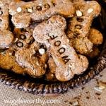 Multi grain peanut butter dog treats in woven bowl