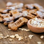 peanut butter and carrot dog treats on wooden table