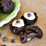 peanut butter and carob pupcakes on woven table mat